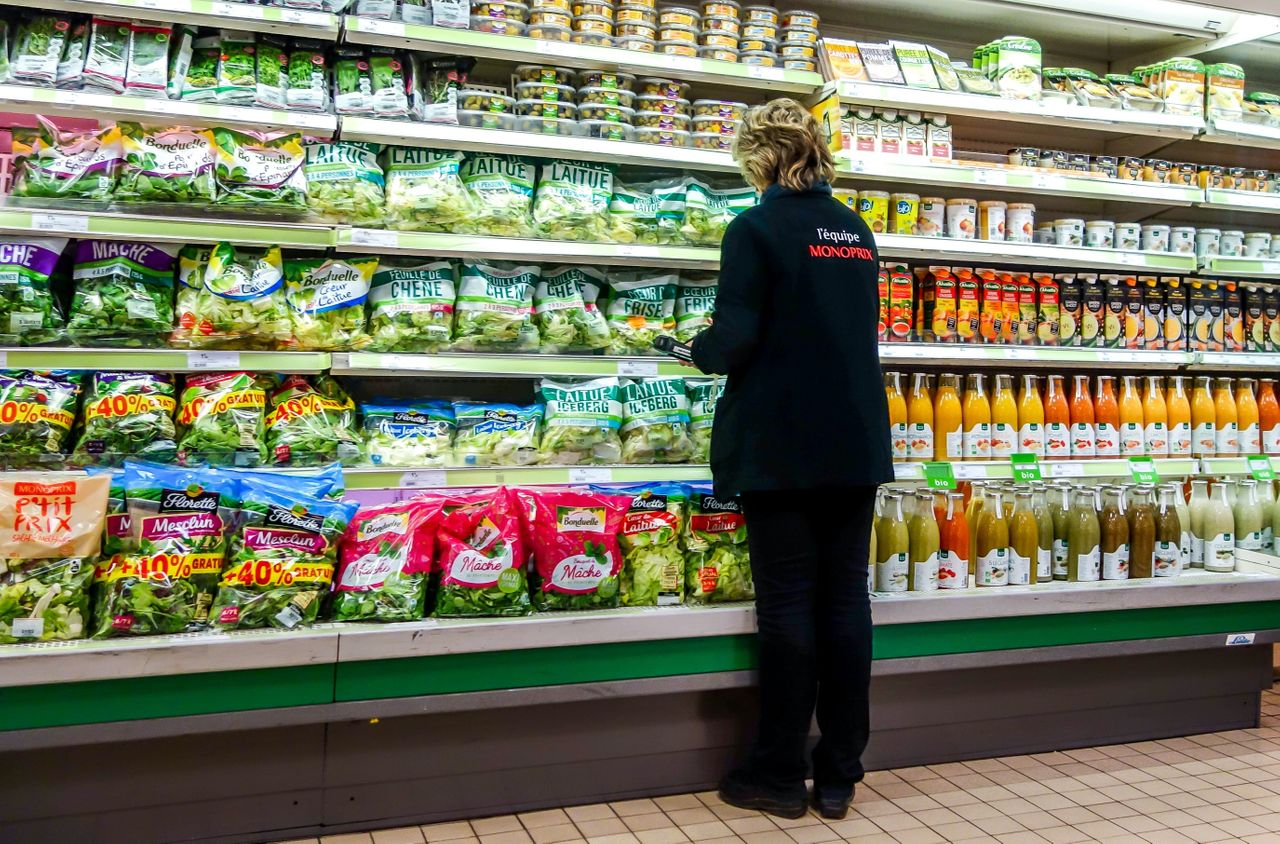 An employee checking shelves in a French supermarket. A 2011 study found that France spent as much to clean up water polluted through conventional farming, mainly from pesticide use, as it did on groceries.