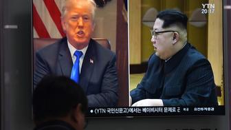 A man watches a television news showing North Korean leader Kim Jong Un (R) and US President Donald Trump (L), at a railway station in Seoul on May 24, 2018. - North Korea has dismantled its nuclear test site, media invited to attend the ceremony said on May 24, in a carefully choreographed move portrayed by the isolated regime as a goodwill gesture ahead of a potential summit next month with the US. (Photo by Jung Yeon-je / AFP)        (Photo credit should read JUNG YEON-JE/AFP/Getty Images)