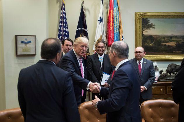Trump shakes Pruitt's hand on June 28,