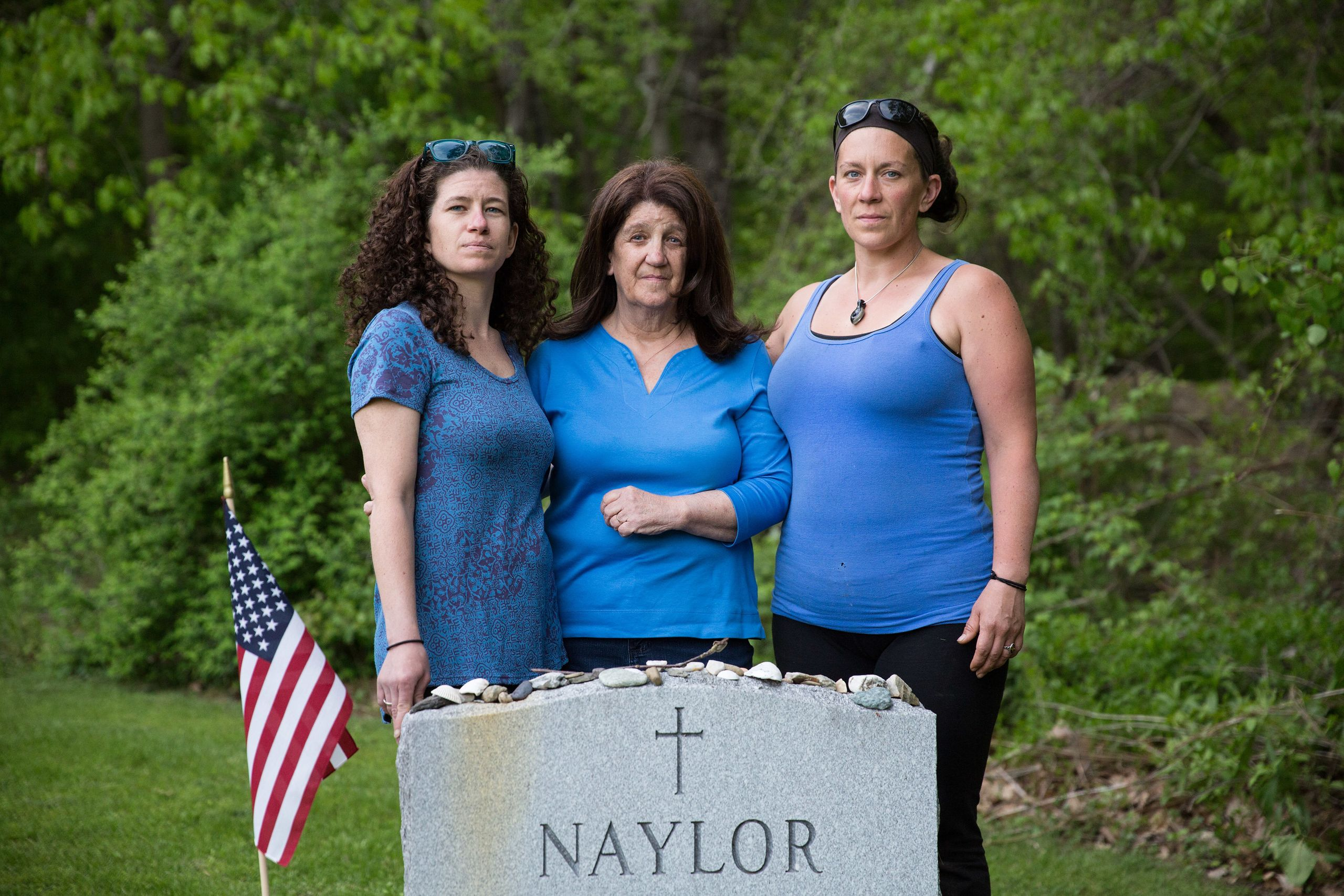 Erin Naylor, Kate Naylor, and Meghan Naylor pose for a portrait during a visit to Pete Naylor's grave in May 2018.