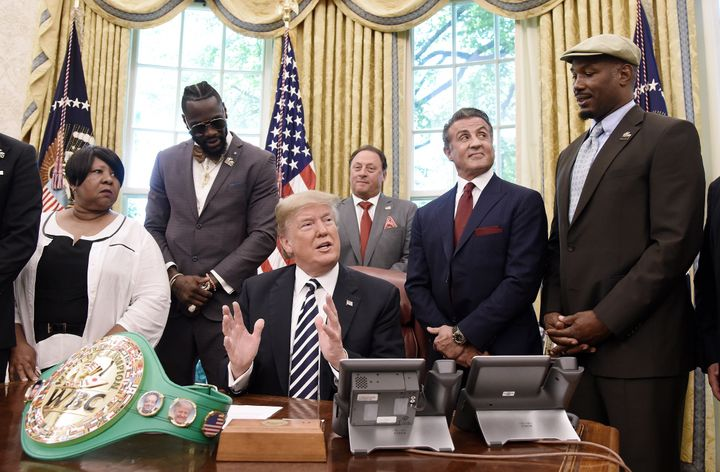Donald Trump speaks after granting posthumous pardon to former heavyweight champion Jack Johnson in the Oval Office on May 24