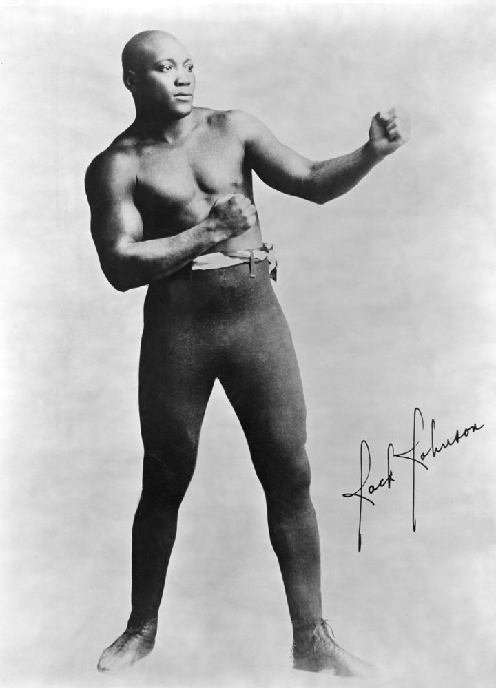 Jack Johnson won his heavyweight boxing world champion title by knocking out Canadian boxer Tommy Burns in 1908.