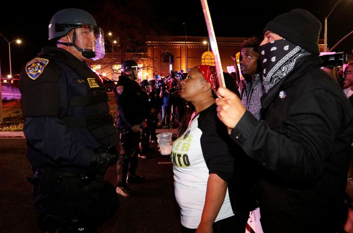 Demonstrators face off with California Highway Patrol officers as they protest the police shooting of Stephon Clark, in Sacra