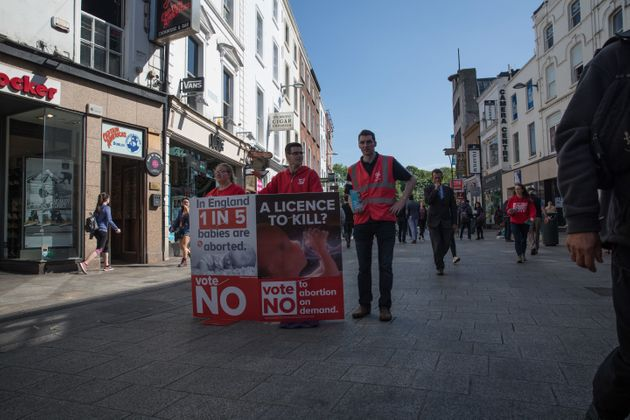 Young anti-abortion campaigners stand on Grafton Street, in Dublin