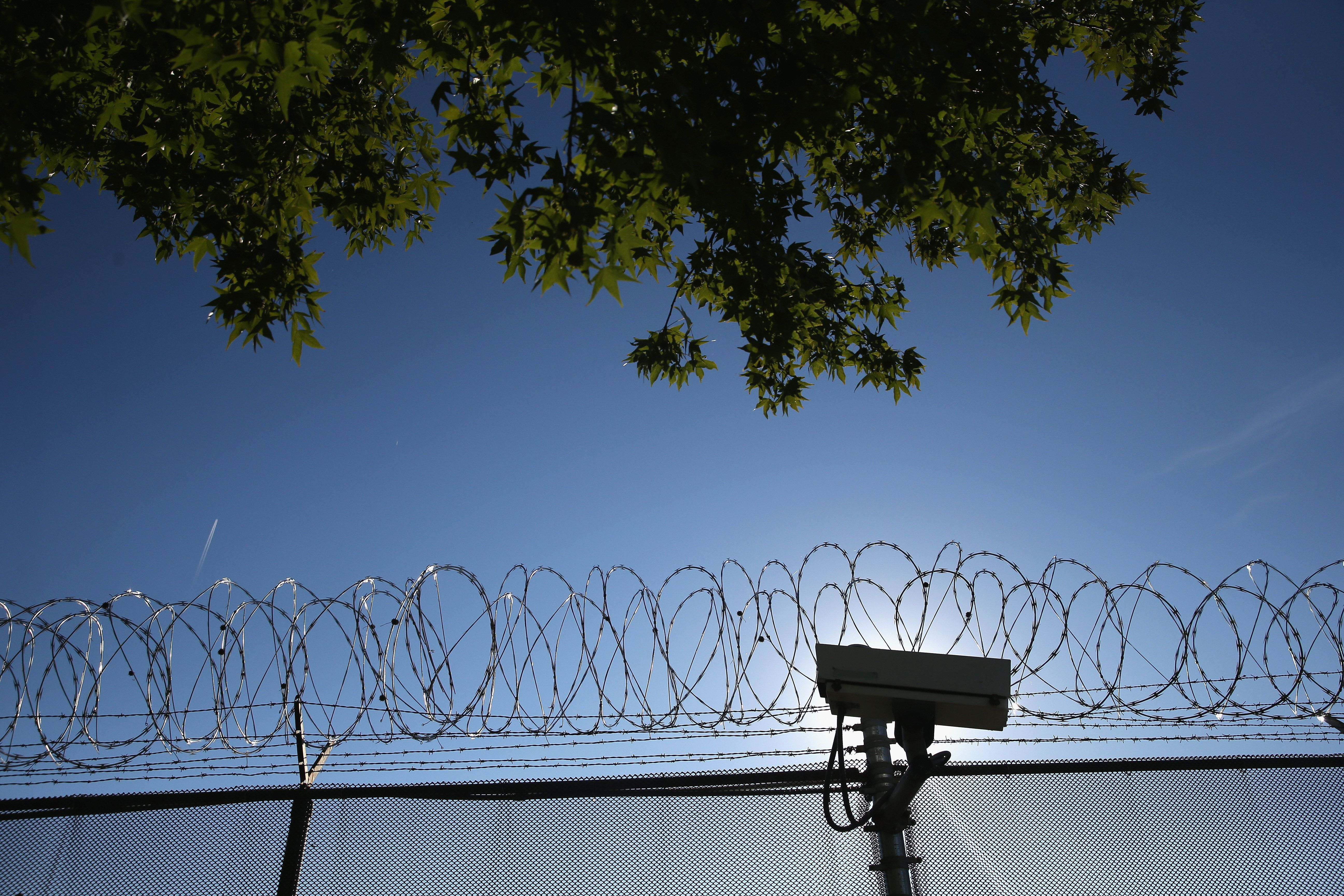 YORK, PA - SEPTEMBER 15:  Concertina wire and a security camera line the perimiter of the York County Dentention Center as immigration reform activists protest on September 15, 2015 in York, Pennsylvania. One hundred women kicked off a week-long 100-mile protest march from the detention center to Washington D.C. ahead of the visit of Pope Francis. The march is part of the We Belong Together campaign to stop immigrant detentions nationwide.  (Photo by John Moore/Getty Images)