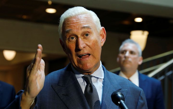 Roger Stone talks to reporters last year after testifying before the House Intelligence Committee.