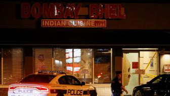 A police officer walks in front of Bombay Bhel restaurant, where two unidentified men set off a bomb late Thursday night, wounding more than a dozen people, in Mississauga, Ontario, Canada May 25, 2018.    REUTERS/Mark Blinch
