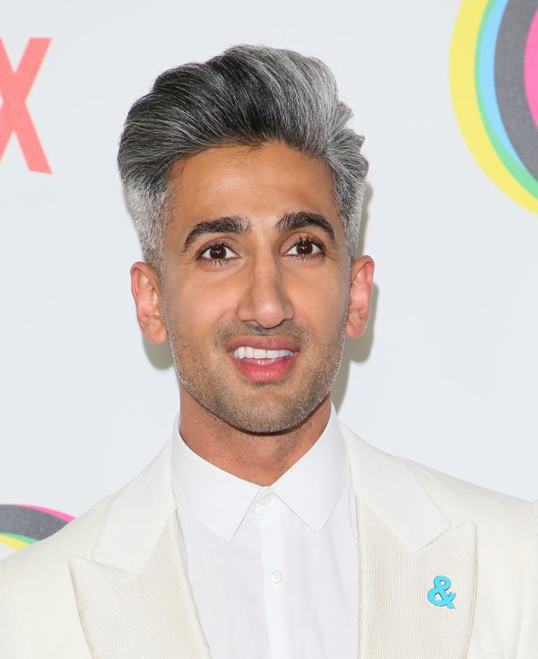 """""""Queer Eye"""" star Tan France is always rocking his signature salt-and-pepper 'do,with plenty of volume on top and clean,"""