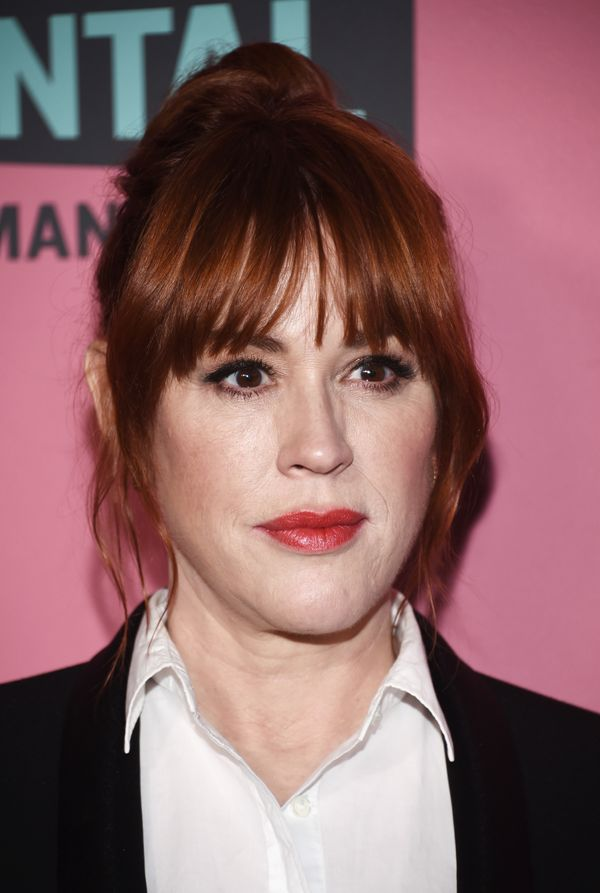 If you want something playful for summer outings or date night, Molly Ringwald's tousled updo with shaggy bangsis perfe
