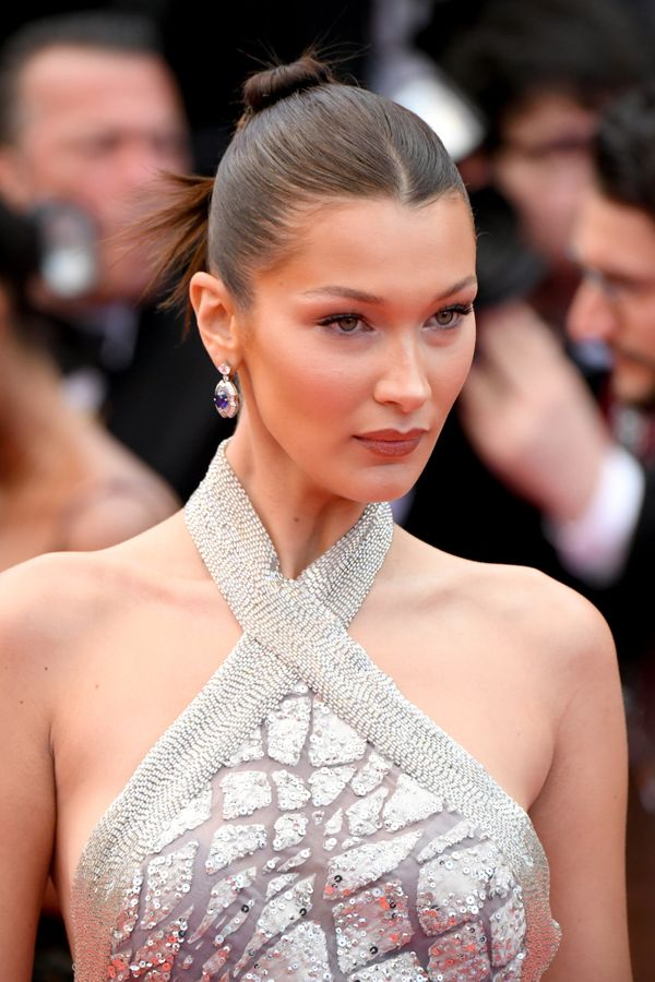 The model's sleek ponytail-bun hybrid is a great style to try, especially when you want to keep frizz at bay. The more gel, t