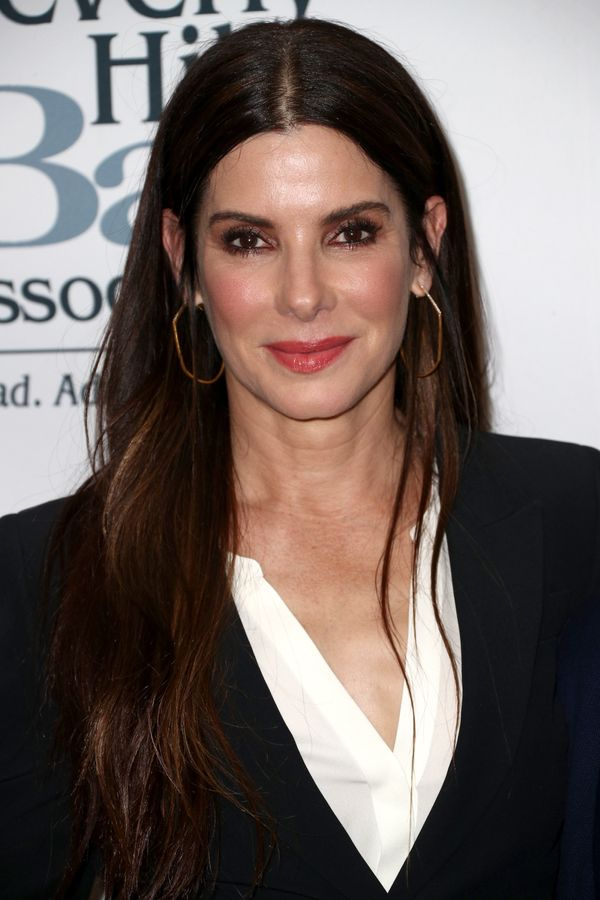Sandra Bullock's signaturehairstyle -- long chocolate-brown locks with just a hint of caramel color toward the ends --&