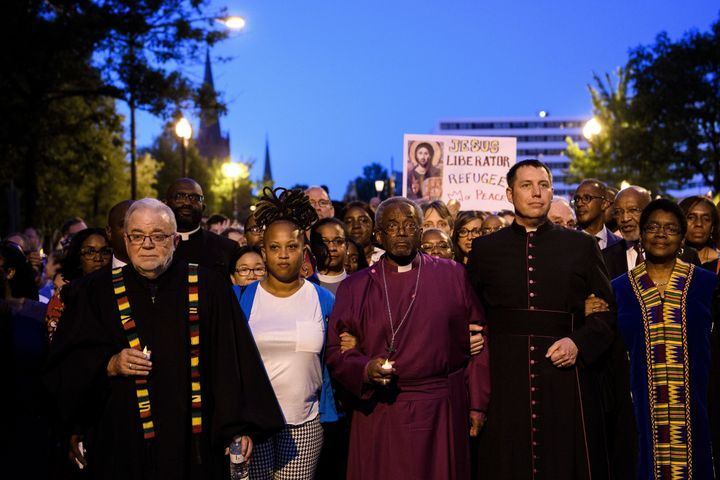 Bishop Michael Curry (C) leaves the National City Christian Church to march to the White House for a vigil on May 24, 2018.