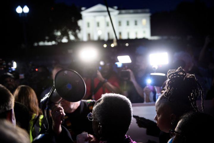 Bishop Michael Curry (C) waits to speak during a vigil outside the White House on May 24, 2018 in Washington, D.C.