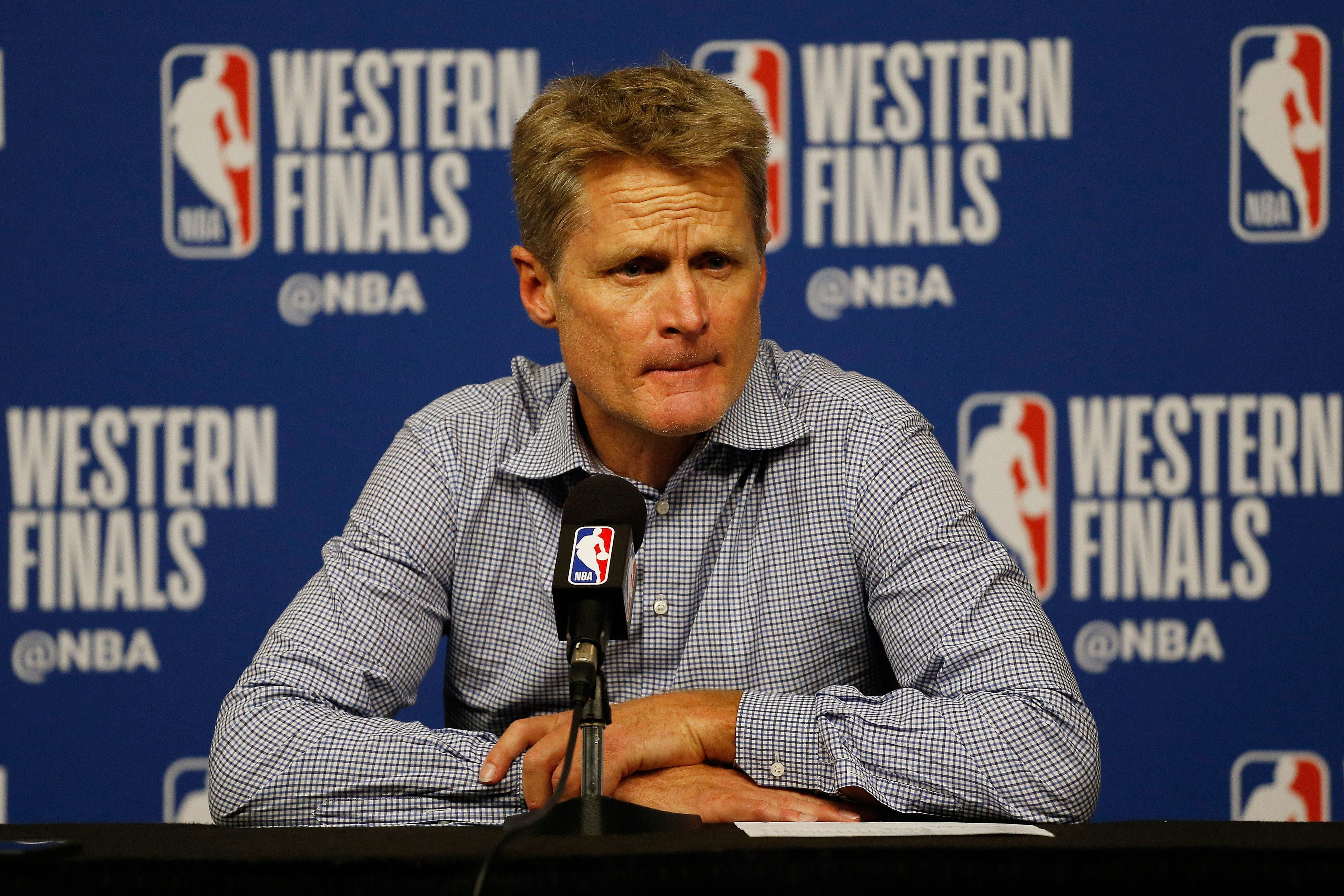 HOUSTON, TX - MAY 24:  Head coach Steve Kerr of the Golden State Warriors speaks to the media after their 94 to 98 loss to the Houston Rockets in Game Five of the Western Conference Finals of the 2018 NBA Playoffs at Toyota Center on May 24, 2018 in Houston, Texas.  (Photo by Bob Levey/Getty Images)