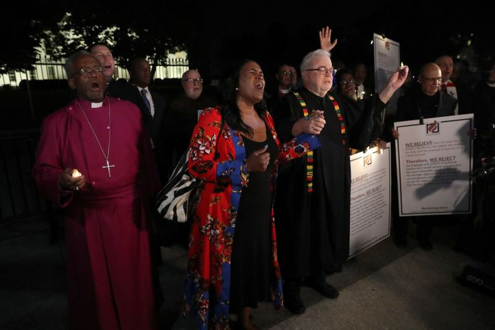 Episcopal Church Presiding Bishop Michael Curry (L) and Sojourners President and Founder Rev. Jim Wallis (R) lead fellow cler