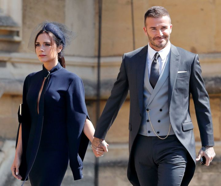 Victoria Beckham, pictured with husband David at the royal wedding, got grief over her neutral facial expression.
