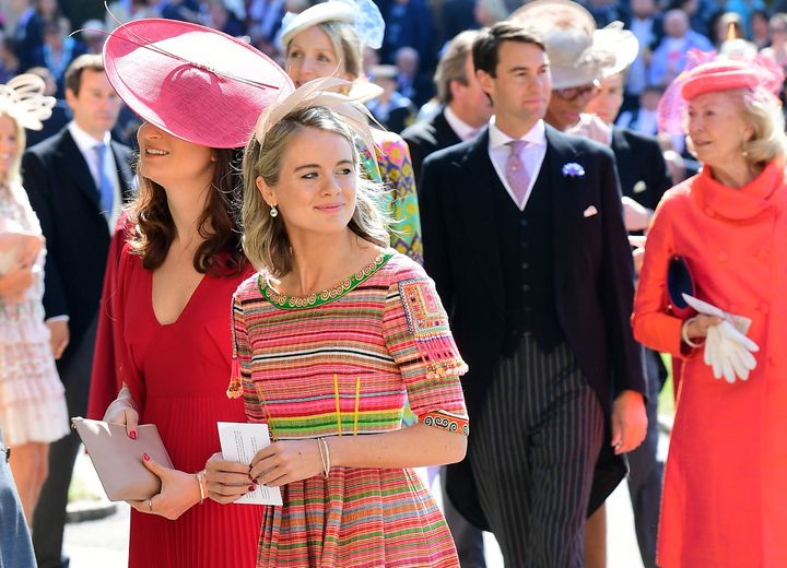 Cressida Bonas wears a bright striped dress with the small feathered fascinator.