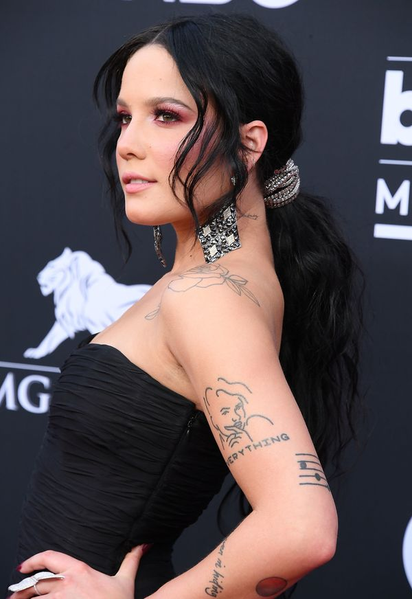 Halsey's low ponytail with tendrils framing her face is the perfect look for a romantic date night.