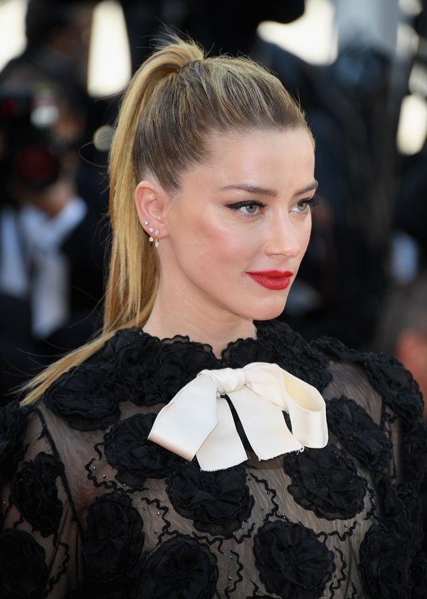 A high ponytail like Amber Heard'sis simple, chic and great for hot weather.