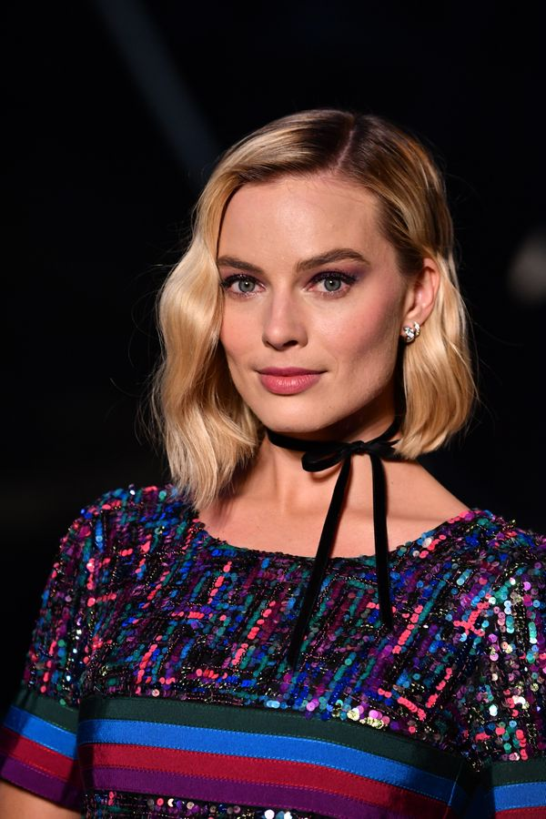 Margot Robbie's wavy bob is classic, butthe asymmetric cut with one side slight longer than the otheradds a moder