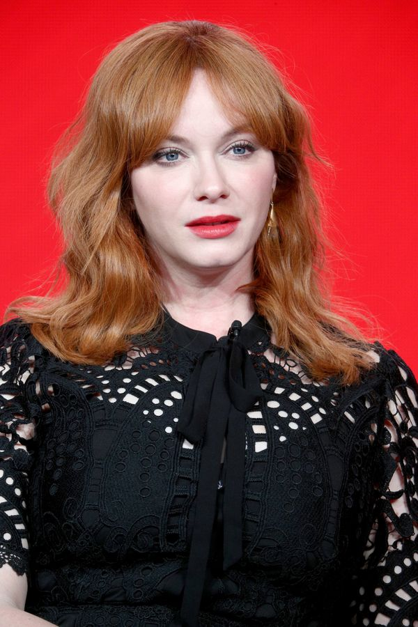 """Christina Hendricks' tousled 'do with """"curtain bangs"""" isgreat for the '70s-obsessed folks out there. It's got vintage v"""