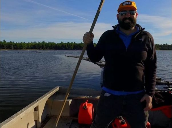 Maxime Daigle often takes to the cold waters off New Brunswick in one of his family's flat-bottomed boats to harvest oysters.