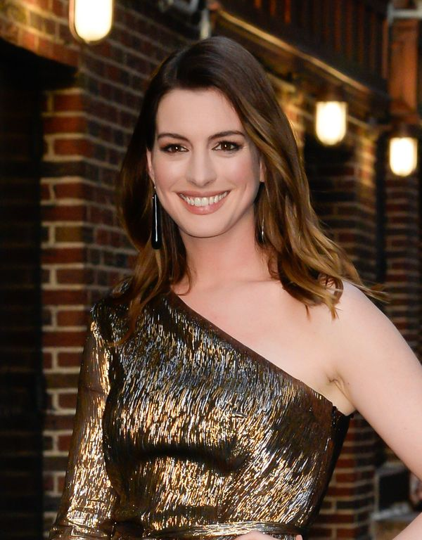 We love Anne Hathaway's carefree waves, touched with just the right amount of golden caramel highlights.