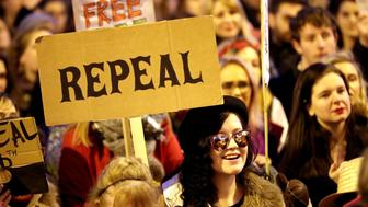 People carrying various signs gather outside The Custom House in Dublin, as participants take part in a march through the city calling for the repeal of the 8th amendment to the Irish constitution. (Photo by Niall Carson/PA Images via Getty Images)