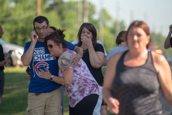 Parents comfort each other as they wait outside Noblesville West Middle School.