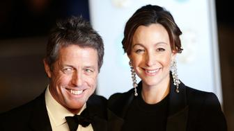 Hugh Grant and Anna Eberstein attending the EE British Academy Film Awards held at the Royal Albert Hall, Kensington Gore, Kensington, London.  PRESS ASSOCIATION Photo. Picture date: Sunday February 18, 2018. See PA Story SHOWBIZ Bafta. Photo credit should read: Yui Mok/PA Wire.  (Photo by Yui Mok/PA Images via Getty Images)
