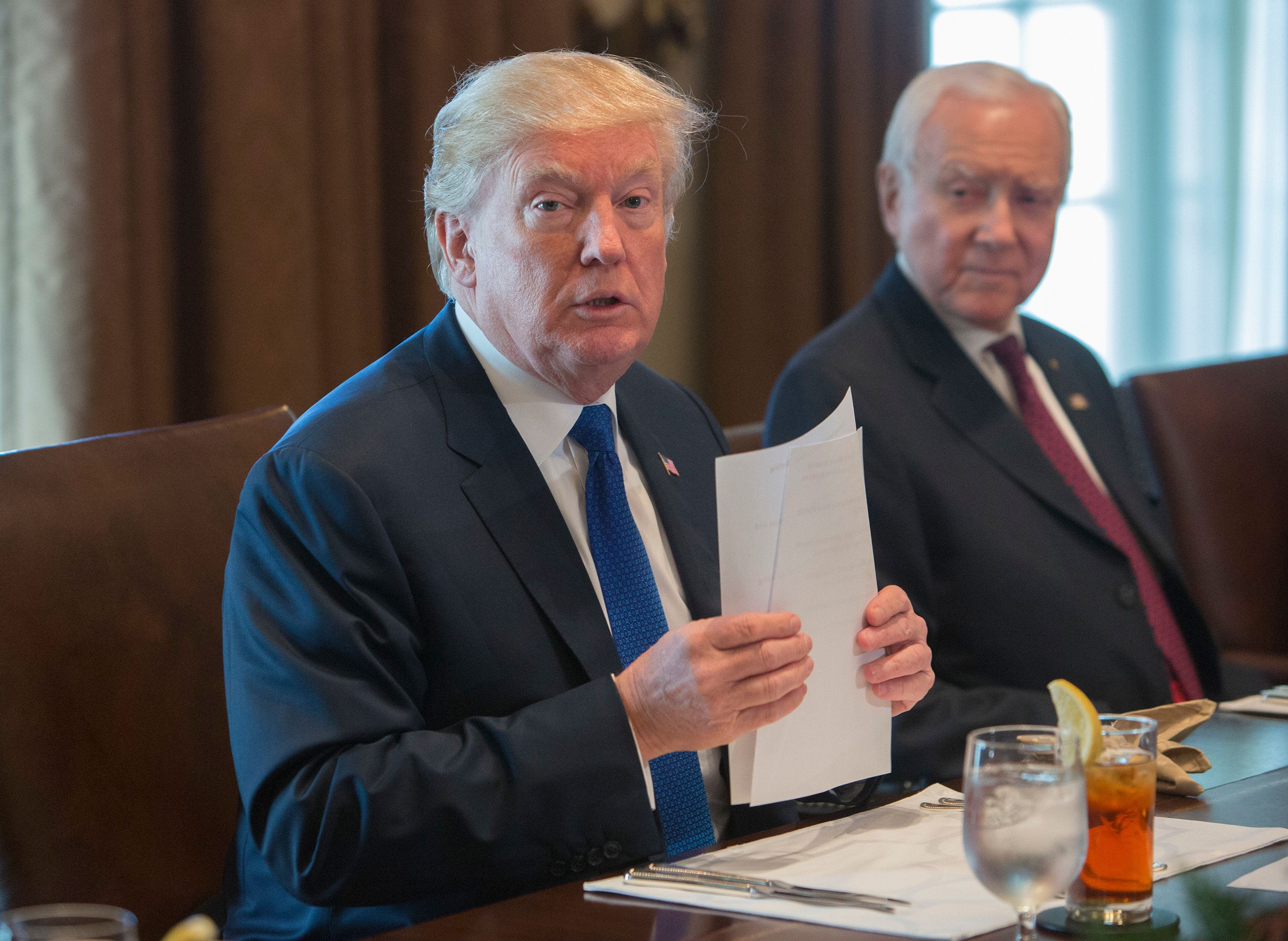 WASHINGTON, DC - DECEMBER 13: (AFP OUT) U.S. President Donald Trump speaks about tax reform during a bicameral meeting on December 13, 2017 at the White House in Washington, DC. Seated right is Senator Orrin Hatch(R-UT). (Photo by Chris Kleponis - Pool/Getty Images)