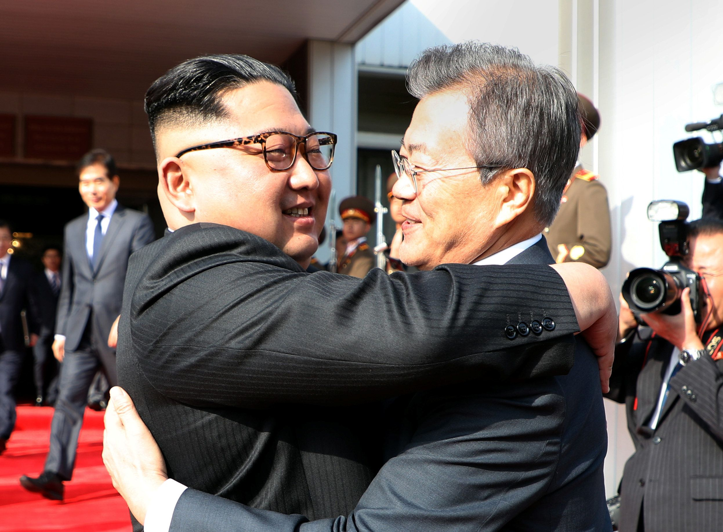 Handout.  Reuters                   Kim Jong Un and Moon Jae In embrace at the border