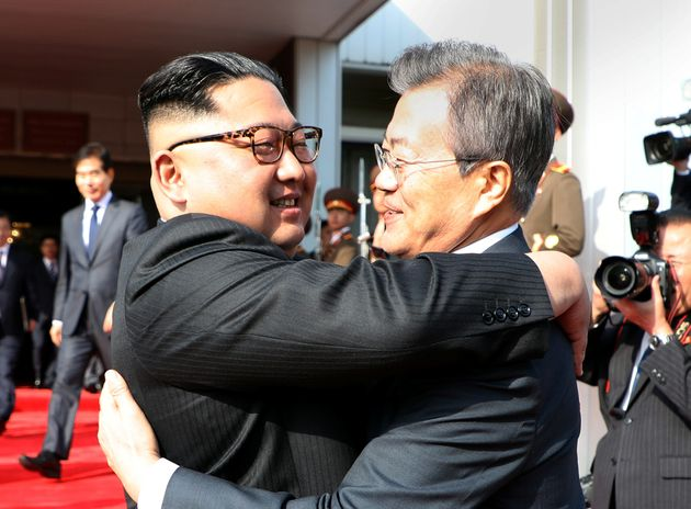 Kim Jong-Un and Moon Jae-In embrace at the
