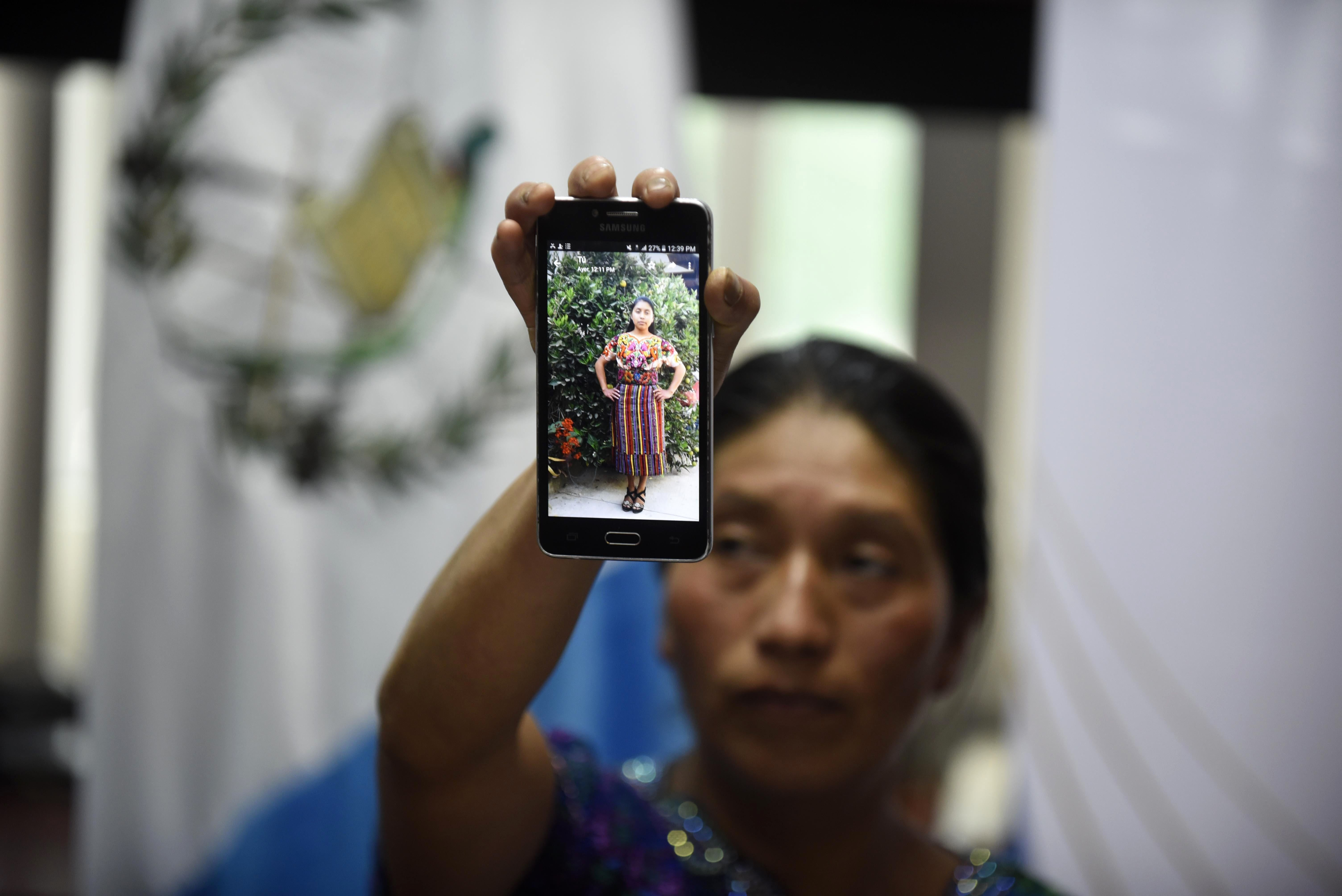 Dominga Vicente shows a photo of her niece Claudia Gomez during a press conference in Guatemala City on May 25, 2018. - The family of a 20-year-old Guatemalan woman who was allegedly shot and killed by a U.S. border patrol agent demanded justice Friday and called for her body to be sent back home so they could bury her in her native village. (Photo by JOHAN ORDONEZ / AFP)        (Photo credit should read JOHAN ORDONEZ/AFP/Getty Images)