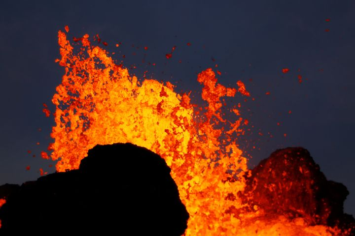 Lava from the Kilauea volcano shoots out of a fissure, in the Leilani Estates near Pahoa, Hawaii, May 26, 2018.