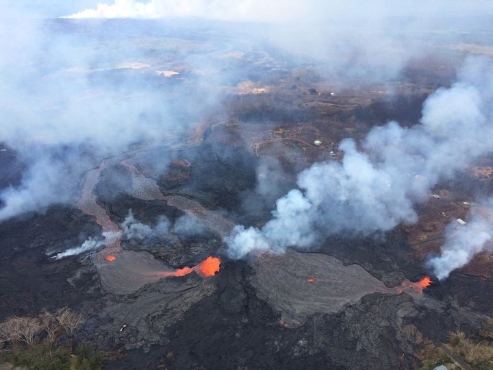 Fissures 6 and 13 show lava flows merging into one channel that flows into the ocean at the western-most entry, in Hawaii, Ma
