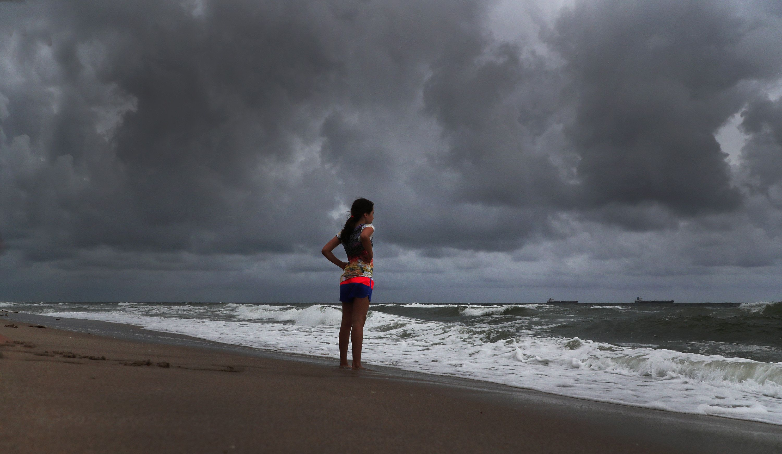 Alicia Herrera, 10, visiting from Germany doesn't let  dark clouds ruin her day at beach Friday, May 25, 2018 in Fort Lauderdale, Fla. A flood watch is expected for South Florida on Saturday morning as a result of Subtropical Storm Alberto. (Carline Jean/Sun Sentinel/TNS via Getty Images)