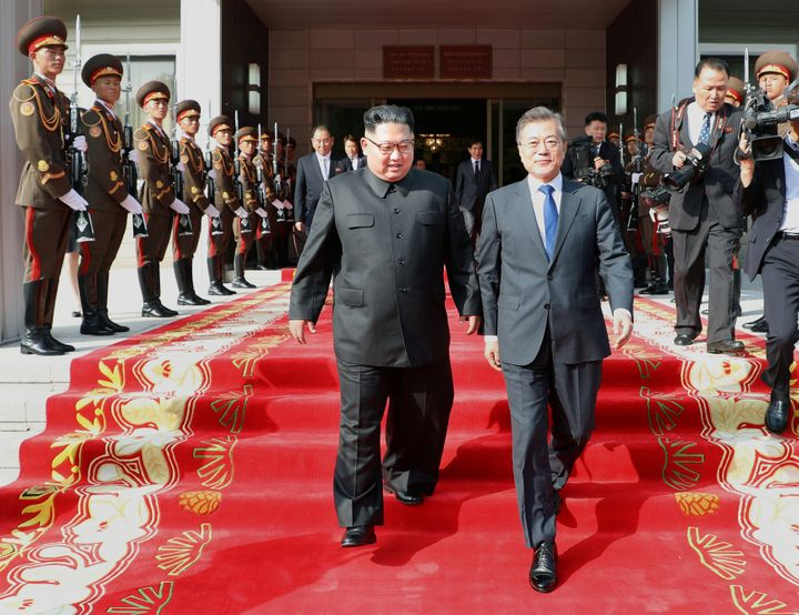 South Korean President Moon Jae-in and North Korean leader Kim Jong Un leave after their summit at the truce village of Panmu