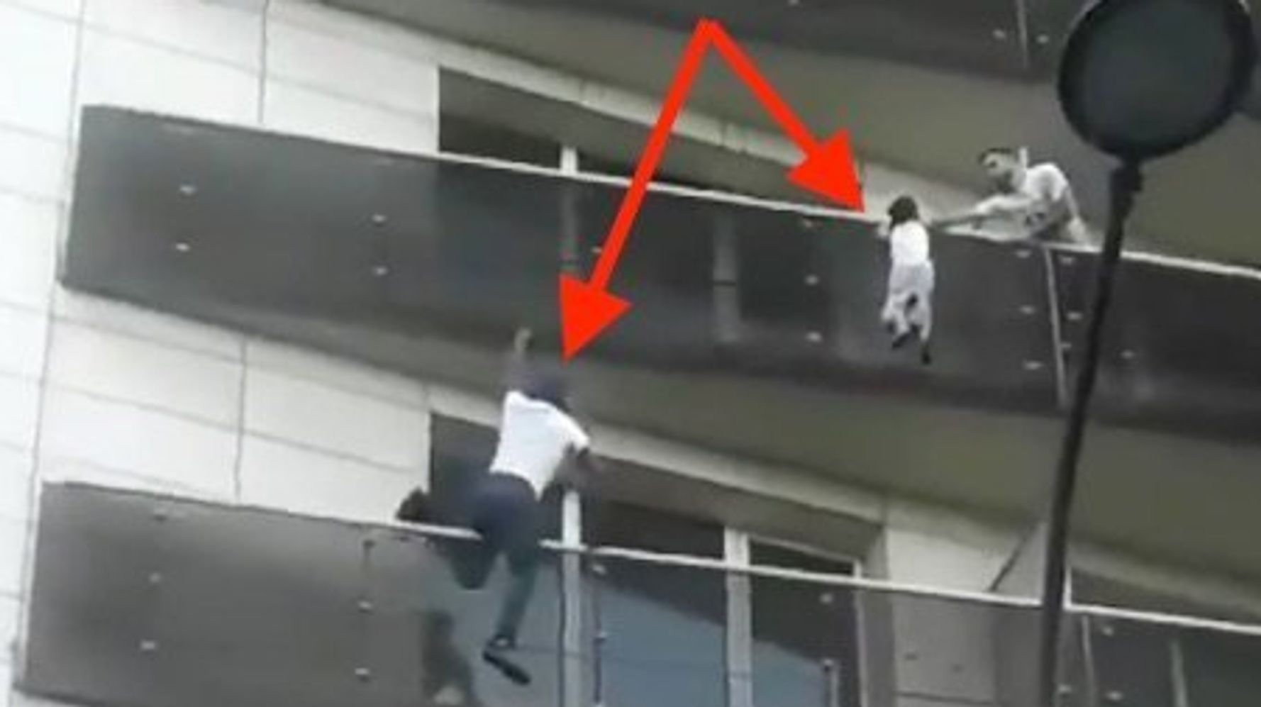 Real-Life Spider-Man Scrambles Up Building To Save A Dangling Child