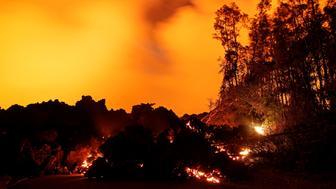 A lava flow from the Kilauea volcano illuminates the night sky, in the Leilani Estates near Pahoa, Hawaii, U.S., May 26, 2018.  REUTERS/Marco Garcia
