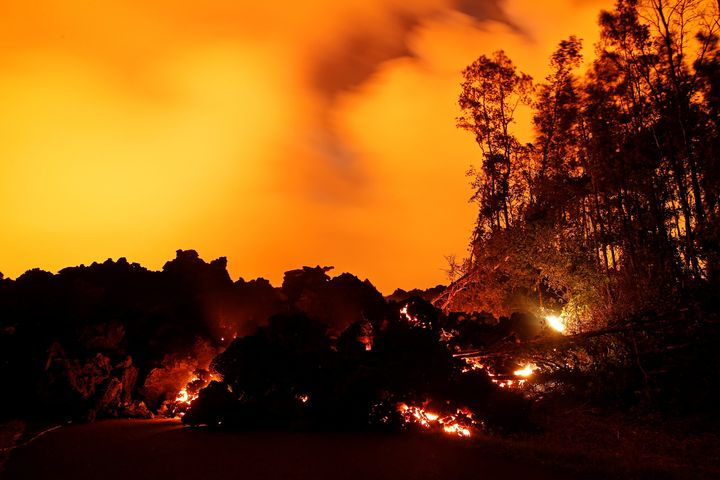 A lava flow from the Kilauea volcano illuminates the night sky near Pahoa, Hawaii.
