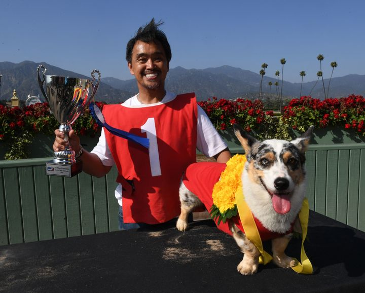 Rick Garcia celebrates with his dog, Roi, after winning the SoCal Corgi Nationals.