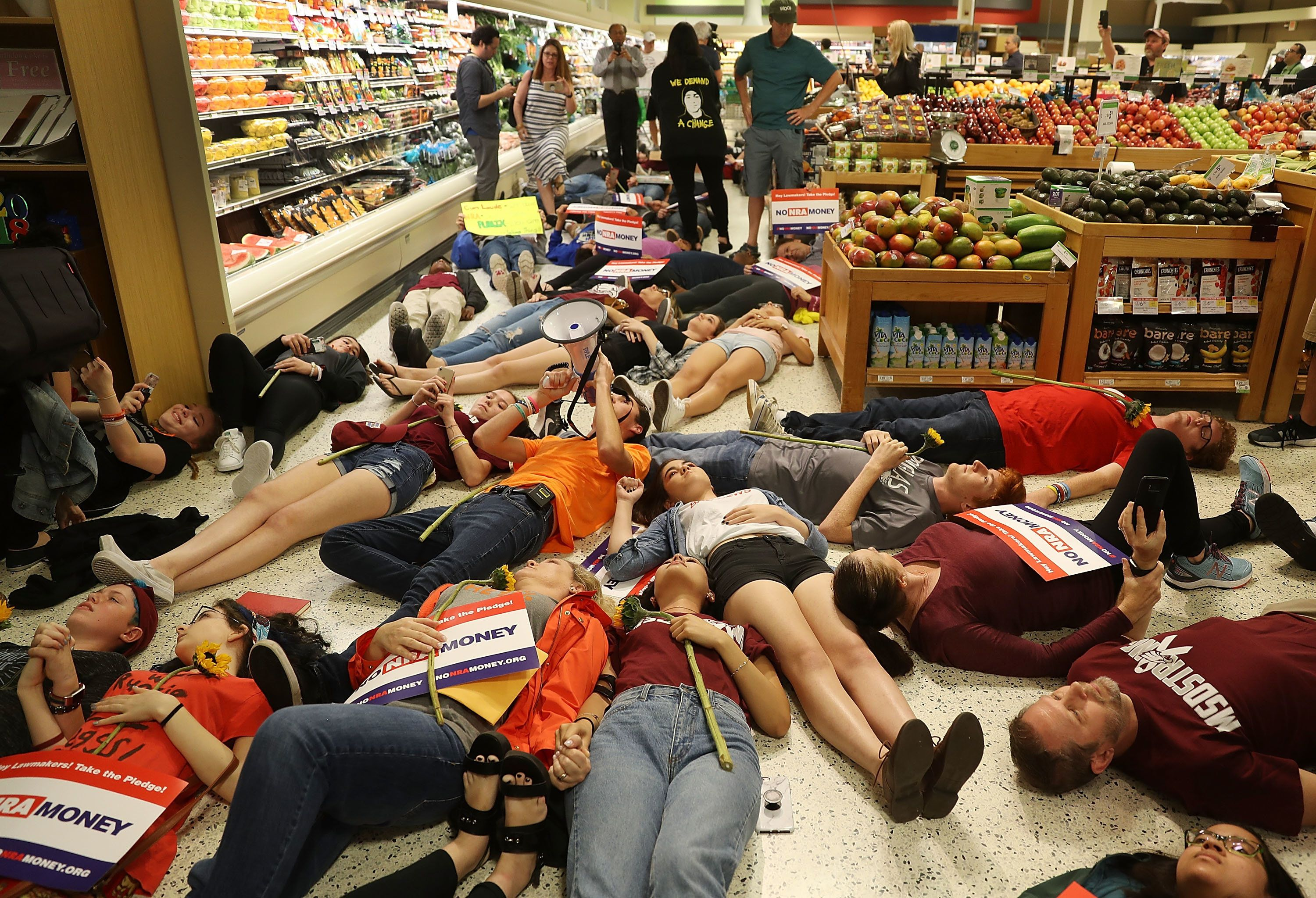 Teen activists stage a die-in at a Publix market in Coral Springs Florida