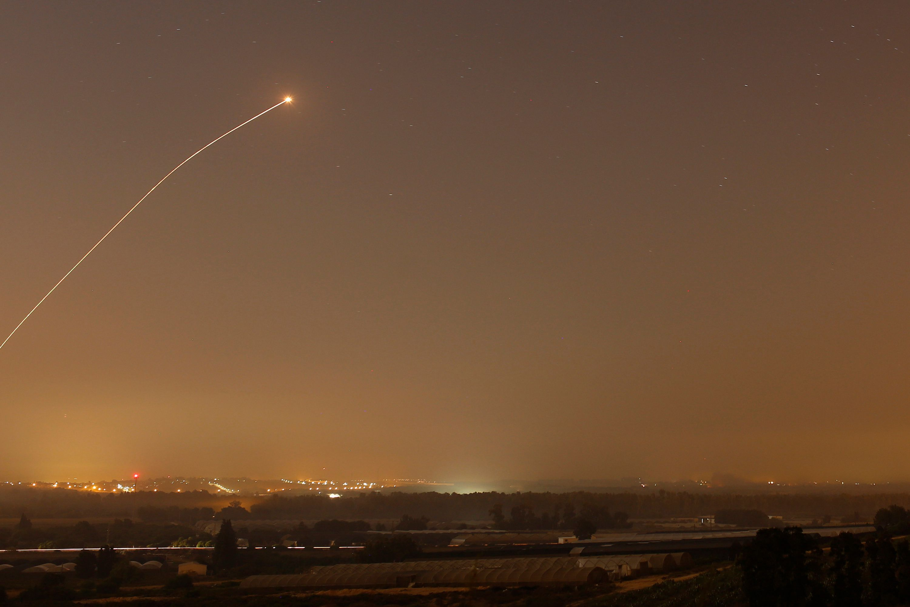 An interception by the Iron Dome anti-missile system is seen as rockets are launched from Gaza towards Israel before a 72-hour ceasefire was due to expire August 13, 2014. At least two rockets fired from the Gaza Strip struck Israel on Wednesday, moments before a three-day truce was set to expire, police said. Spokesman Micky Rosenfeld said two rockets landed in open areas causing no damage or casualties. The attacks occurred as Palestinians announced agreement to extend a truce expiring at 2100 gmt Wednesday for another five days. REUTERS/Amir Cohen (ISRAEL - Tags: POLITICS CIVIL UNREST MILITARY CONFLICT TPX IMAGES OF THE DAY)