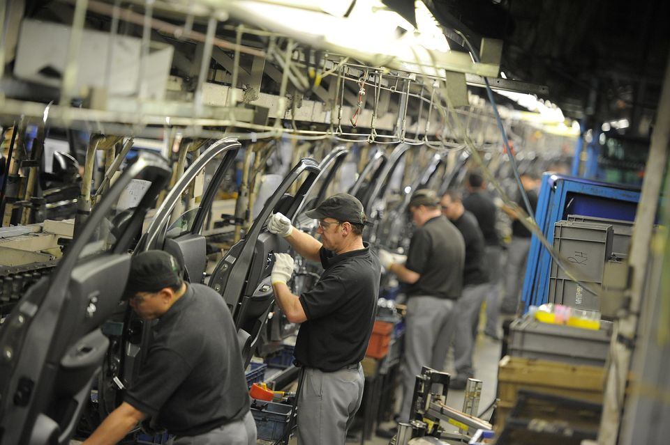 Workers preparing doors for the Qashqai car at the Nissan car plant in