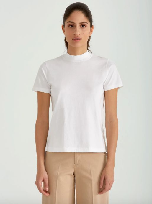 """Get it at <a href=""""https://www.frankandoak.com/product/77-2120136-017/mock-neck-tee-in-bright-white"""" target=""""_blank"""">Frank An"""
