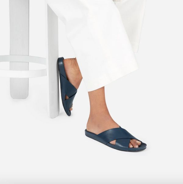 """Get it at <a href=""""https://www.everlane.com/products/womens-molded-lthr-cross-slide-sandal-navy?collection=womens-newest-arri"""