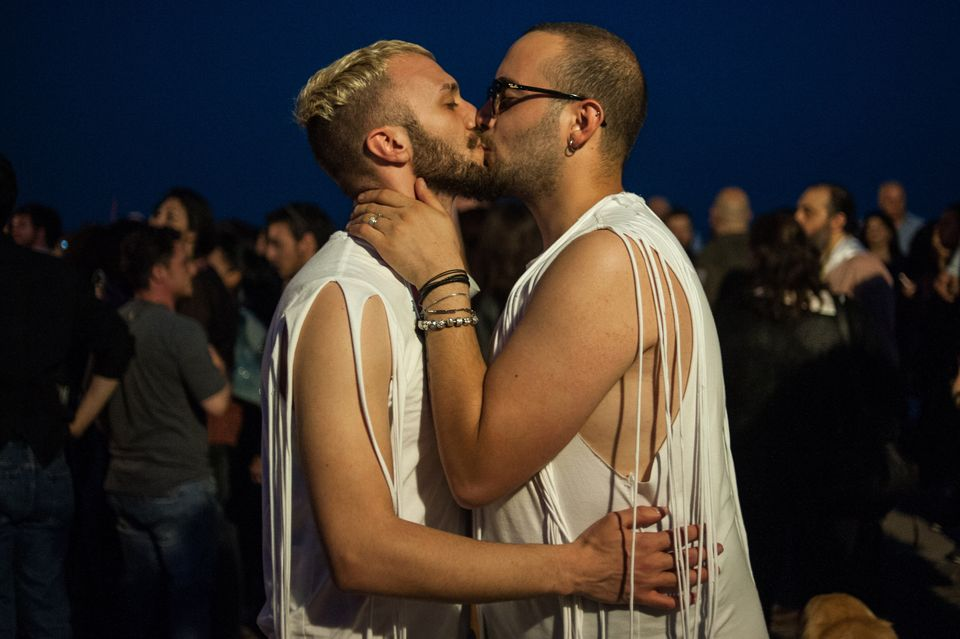 Two men celebrate at a Pride parade in Salerno, Italy, on May 26, 2018.