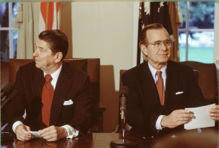 President Ronald Reagan and Vice President George H.W. Bush hold a meeting in the White House Cabinet Room, circa 1983.