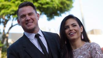 "Cast member Channing Tatum (L) and his wife Jenna Dewan pose at the premiere of ""22 Jump Street"" in Los Angeles, California June 10, 2014. The movie opens in the U.S. on June 13.   REUTERS/Mario Anzuoni  (UNITED STATES - Tags: ENTERTAINMENT)"